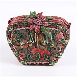 """Mary Frances Handbag: A Mary Frances handcrafted handbag. The hard-shell bag has a tapestry finish accented by beaded sections and a large beaded floral clasp. The bag has a black and red rope strap and is marked """"Mary Frances"""" to the interior."""