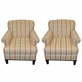 Pair of Upholstered Plaid Armchairs by C.R. Laine: A pair of upholstered armchairs by C.R. Laine. Armchairs feature plush seating and are matching. They are upholstered in a yellow, sage green, cream and orange plaid sateen fabric. Seat backs are rounded, arms are rolled and the frame sits atop four chocolate brown tapered feet.