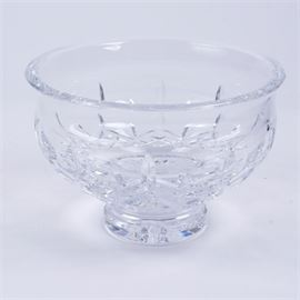 "Waterford Crystal ""Lismore"" Footed Bowl: A crystal bowl by Waterford in the Lismore pattern. This footed bowl features vertical and cross cuts. It is marked ""Waterford'"" to the verso."