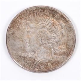 1924 Peace Silver Dollar: A 1924 Peace silver dollar. Designer: Anthony de Francisci. Mintage: 11,811,000. Metal Content: 90% silver, 10% copper. Diameter: 38.1 mm. Weight: 26.80 grams. Circulated. Good to fair condition.