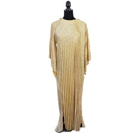 Vintage Gold Caftan Dress: A vintage gold caftan dress. The dress has a pleated drape design with a draw string around the neck and wide batwing style arms. The dress is 53-inches in length.