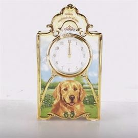 Bradford Exchange Porcelain Clock with Golden Retriever: A porcelain clock featuring a golden retriever from Bradford Exchange. The clock is battery operated and has a golden retriever painted on front and the line Goldens are friends for all time. The art is by Linda Pickens. A certificate of authenticity is included.