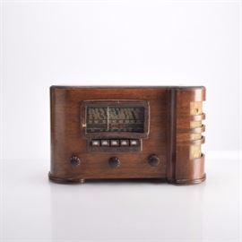 Crosley Vintage Tube Radio: A Crosley vintage tube radio. The radio is in a walnut case with speakers on the side. It has both push button and knob dials. The back is missing.