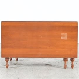 Cherry Drop Leaf Table: A cherry drop leaf table. This table is a rectangular design. Each drop leaf is twenty-two inches wide and is set on six turned legs with turnip feet.