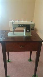 Sewing machine in original cabinet - still working $80