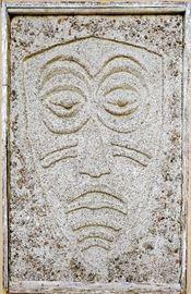 Concrete tiki wall sculpture