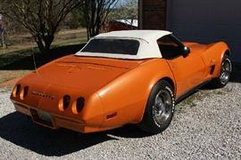 4 - 1974 Corvette Stingray convertible, soft and hard white top, orange body, tan interior in running and drivable condition, 70,000 miles