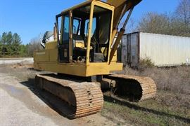 12 - John Deere 1980 Model, 610 Track Hoe, operational in working order.