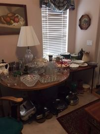 Various pots and pans, large crystal serving pieces, glassware, dishes