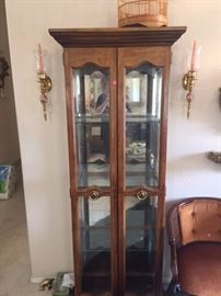 Tall narrow hutch with wood and glass, candle sconces, chair