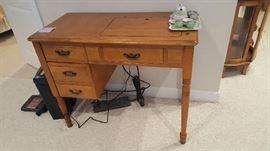 Singer Sewing machine and cabinet   $50  Buy ahead
