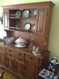 This is a Tell City solid Maple china cabinet.  $300