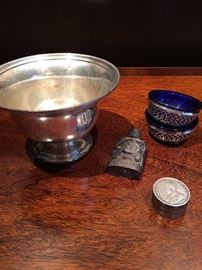 Sterling silver bowl, perfume, and other trinkets.