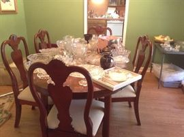 Beautiful Cherry finished table with leaves and table top pads 5 Chairs