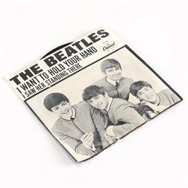 "Beatles ""I Saw Her Standing There""/""I Want to Hold Your Hand"" Single First Pressing: A first pressing of the Beatles' single I Want to Hold Your Hand/I Saw Her Standing There. Released in 1964 on Capitol Records, this original pressing is identified by the yellow and orange swirl and the name Walter Hofer on the I Saw Here Standing There side above the ""2:50"" time mark."