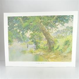 """Paul Sawyier Limited Edition Print """"North Elkhorn Mill Pond"""": A limited edition offset lithograph print of North Elkhorn Mill Pond after Kentucky artist Paul Sawyier (1865-1917). This piece shows a fisherman in the distance, wading in the pond with a sloping bank to the right and a row of buildings in the background. The print is numbered 1257 out of 5000, copyrighted 1974 by American Collectors Exchange, Inc. It includes a certificate of authenticity and a protective folder."""