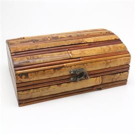 Bamboo and Wood Chest: A bamboo and wood chest. Featuring warm brown tones, this wood chest includes an exterior constructed from bamboo. The piece also showcases a front latch, hinged lid and a dual compartment interior. No visible maker's mark.