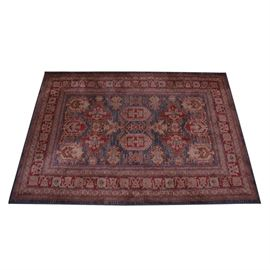 Momeni Ghazni Collection Power Loomed Area Rug: A Ghazni Collection area rug by Momeni. The rug is power loomed from 100% polypropylene in the GZ-01 pattern. The traditional Afghani design in red, cream and blue is bound to all sides, retains original tags to underside. Make in Turkey.