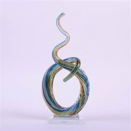 Abstract Glass Sculpture by Murano: An abstract glass sculpture by Murano. An abstract figure with multiple colors that has a round base and then continues to curve and twist up to a point.