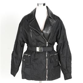 """Prada Coat: A women's coat by Prada. The jacket features two zippered pockets, one zippered breast pocket, a belt with a silver-tone buckle marked """"Prada"""", an elastic waistband and a leather removable collar. The jacket is made of nylon and is a size medium. A Prada label is sewn to the interior."""