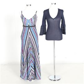 Assorted Women's Clothing: An assortment of women's clothing. The assortment features a spaghetti strap maxi dress with blue, pink, yellow, black, and white geometric pattern work and a black ribbon at the waist. The dress is made by Caché and is made of a nylon and spandex fabric blend. Also included is a blue quarter sleeve top with ruffle and lace detailing on the sleeves that was made by Missoni.