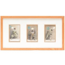 Antique Hand Colored French Postcards With Original Stamps: A trio of antique hand-colored French postcards with their original stamps. Depicted are playful clowns. They are marked '631/7', '631/2', '631/4'. They are presented in a white matte and a natural wood composite moulding.