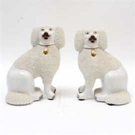 Pair of Vintage Jeanne Reed's Staffordshire Dogs: Pair of Jeanne Reed's Staffordshire Dogs. The dogs are in an off-white glaze, with textural fur patterning and black and gold details. Both are marked to the verso.