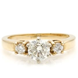 14K Yellow Gold Diamond Ring: A 14K yellow gold diamond ring. The total approximate group diamond weight is 0.69 ctw.