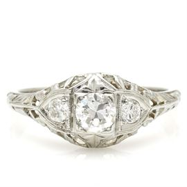 18K White Gold Diamond Ring: A 18K white gold diamond ring. The total approximate group diamond weight is 0.39 ctw.