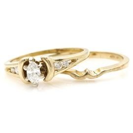 14K Yellow Gold and Diamond Bridal Set: A 14K yellow gold and diamond bridal set. The total approximate group diamond weight is 0.27 ctw.