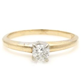 14K Yellow Gold Diamond Solitaire Ring: A 14K yellow gold diamond solitaire ring.