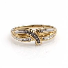 10K Yellow Gold Diamond Ring: A 10K yellow gold diamond ring. The total approximate group diamond weight is 0.11 ctw.