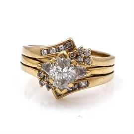 14K and 18K Yellow Gold Diamond Ring: An 18K yellow gold diamond ring. The total approximate group diamond weight is 1.41 ctw.