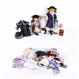 """""""Samantha"""" and """"Nellie American Girl Dolls with Clothing and Accessories: A """"Samantha"""" and """"Nellie American Girl Doll with Clothing and Accessories. The """"Samantha"""" doll is wearing a plaid dress and velvet hat. The """"Nellie"""" doll is wearing a winder coat and hat. Included are various accessories including two miniature dolls, school supplies, white dress with pink ribbon, ice cream maker, Christmas dress, garden part dress, sailor outfit with hat, pajamas for both dolls, and a purple dress with hat."""