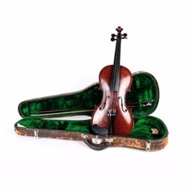 """Vintage Violin with Carrying Case: A vintage violin with carrying case. The Violin is marked inside """"Stradivarius model made from JW Pepper and Sons Philadelphia Franz Liebig Dresden."""" The bow is included inside a carrying case lined with green velvet."""