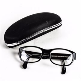 Giorgio Armani Glasses: A pair of Giorgio Armani glasses with black frames. These glasses are marked Giorgio Armani to the exterior and interior of each arm. Includes a matching black sunglasses case by Giorgio Armani.
