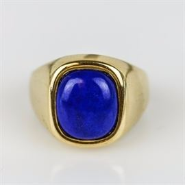 Men's Vintage English 9K Yellow Gold and Lapis Lazuli Ring: A men's vintage English 9K yellow gold ring accented by one center bezel set lapis lazuli cushion cut cabochon.