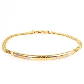 14K Yellow Gold Curved Bar Bracelet: A 14K yellow gold curved bar bracelet featuring a diagonal white and yellow brushed gold design.