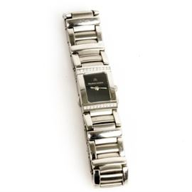 Maurice Lacroix Stainless Steel and Diamond Women's Wristwatch: A stainless steel Maurice Lacroix women's wristwatch. It features a rectangular case with a diamond bezel, a black dial with no hour markers, and a steel link bracelet.