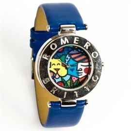 "Romero Britto Stainless Steel Women's Wristwatch: A silver tone base metal Romero Britto women's wristwatch depicting one of Britto's abstract works to the dial with a silver tone case engraved ""Romero Britto"". It has a blue leather strap and is untested."