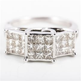 10K White Gold and 3.60 CTW Diamond Past, Present, Future Ring: A 10K white gold past, present, future engagement ring featuring three center squares of invisible set princess cut diamonds in a trellis setting with channel set round brilliant cut diamond side stones. There is a small flush set diamond to the interior. The diamonds have a total approximate weight of 3.60 ctw.