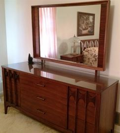 Mid-Century Two Tone Walnut and Oak Kent Coffey Sculpted Front Dresser 1960s Perspecta Collection w/ Attached Mirror (Part of Six-Piece Bedroom Set)
