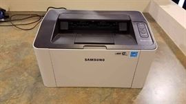 Assorted wifi enabled laser printers from various manufacturers including HP, Samsung, Pantum, Epson, Brother, and more