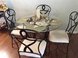 Wrought Iron Table with Glass Top and Four Wrougnt Iron Chairs