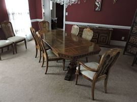 Dining room table with 2 captain and 6 side chairs shown with 2 leafs installed