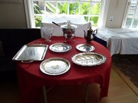 silver plated trays and coffee pot and other items.