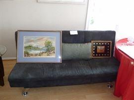 Futon with art work displayed.
