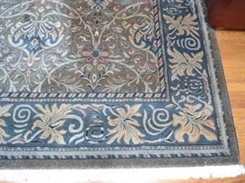 """Rug measuring approximately 11'6"""" X 8'"""