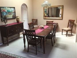 Gorgeous Dining Table w/ 2 leaves & 6 Chairs                Matching Buffet (priced seperately).                                Lg Mirror
