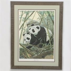 """John Ruthven Limited Edition Offset Lithograph """"Giant Pandas"""": A limited edition offset lithograph after John Ruthven's Giant Pandas. This print depicts two pandas enclosed in a bamboo forest, one of which is standing on its paws eating a branch. An in plate and graphite signature are seen to the lower right corner of the composition, which is accompanied by a proof edition (2283/5000) and printed title to the margins. The print is presented under acrylic glass beneath double matting in a dark, natural wooden frame. To the verso is hanging wire, affixed sticker with print information, and a sepia tone composition of the print containing printed information on it tucked in the paper backing."""
